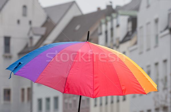Stok fotoğraf: Açmak · gökkuşağı · şemsiye · şehir · turuncu · binalar