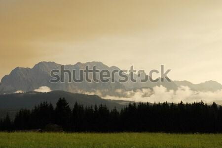 Alpine gün batımı dağlar Almanya ağaç bulutlar Stok fotoğraf © manfredxy
