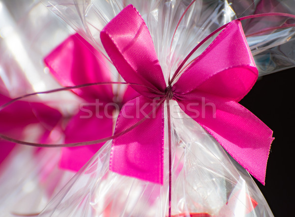 Present in a cellophane foil with a pink bow Stock photo © manfredxy