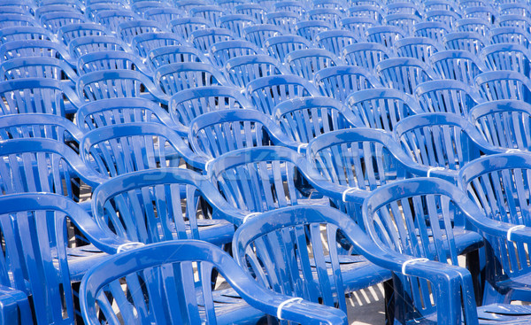 Many rows of blue pastic chairs Stock photo © manfredxy