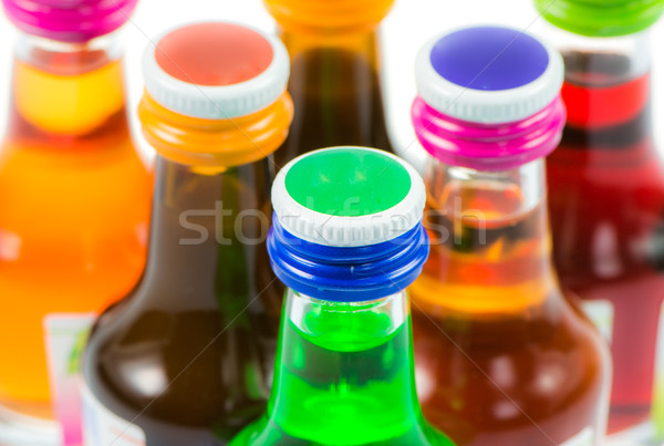 Various isolated liqueur bottles with party drinks Stock photo © manfredxy
