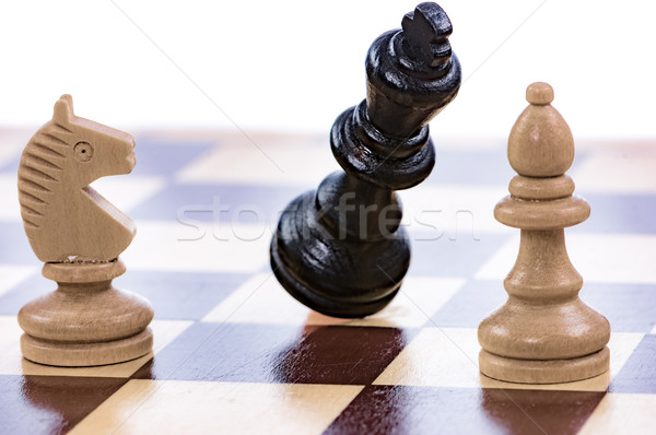 Game of chess with a falling king Stock photo © manfredxy