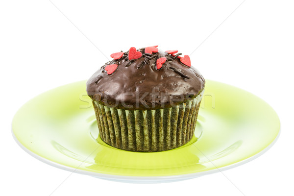 Isolated chocolate muffin on a green plate Stock photo © manfredxy