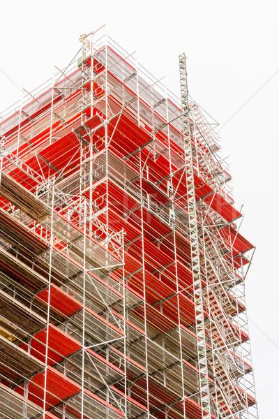 строительные леса строительная площадка фасад высокий дома строительство Сток-фото © manfredxy
