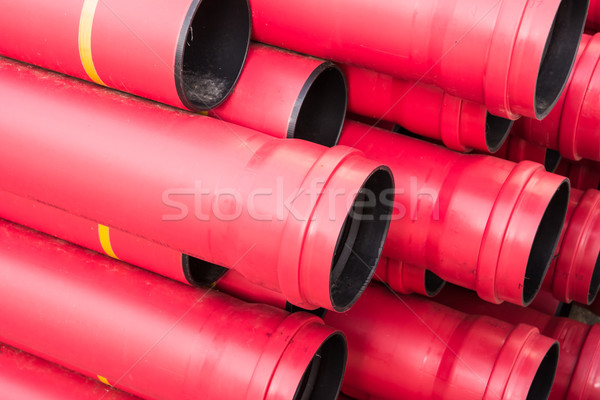 Stack of red pvc protective pipes Stock photo © manfredxy