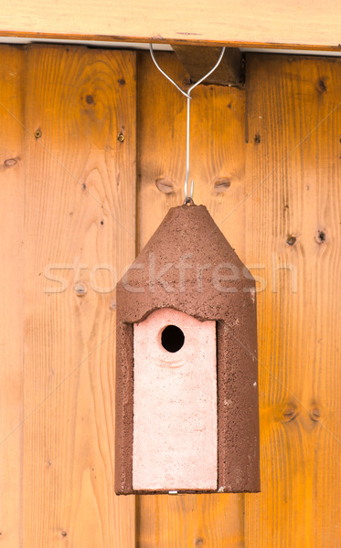 Birdhouse hanging at a wooden hut Stock photo © manfredxy