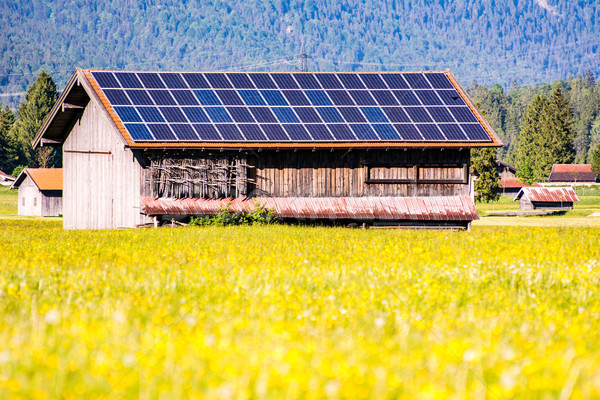 Barn wih photovoltaic cells on the roof Stock photo © manfredxy