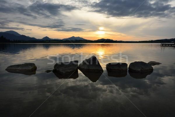 Eau roches lac coucher du soleil ciel paysage Photo stock © manfredxy