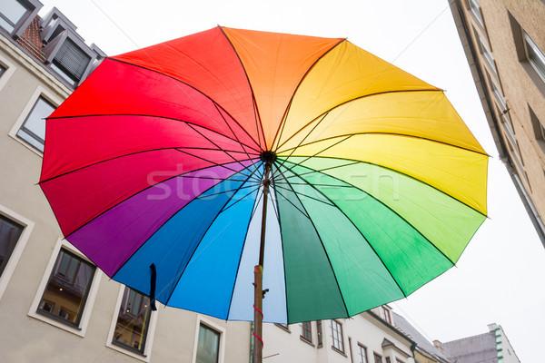 Open rainbow coloured umbrella Stock photo © manfredxy
