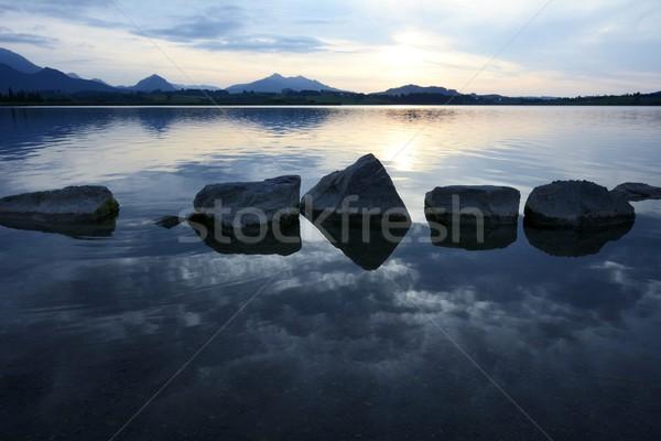 Agua rocas lago puesta de sol cielo paisaje Foto stock © manfredxy