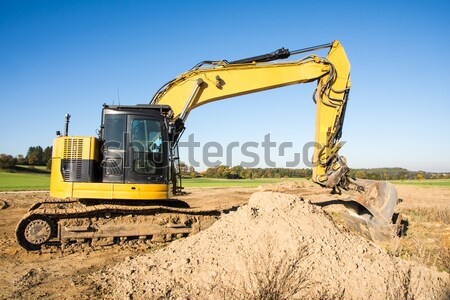 Yellow earth mover at a construction site Stock photo © manfredxy
