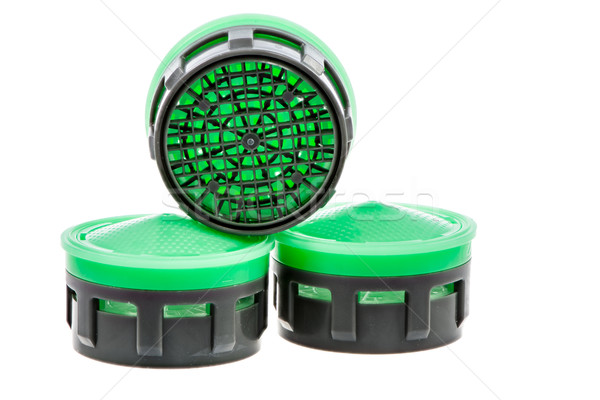 Three isolated plastic faucet aerators Stock photo © manfredxy