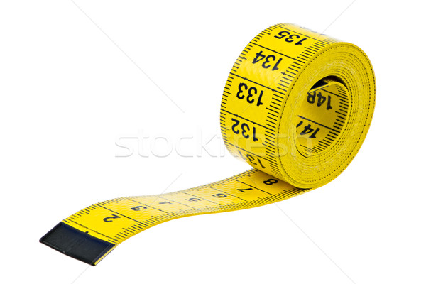 Isolated yellow measuring tape Stock photo © manfredxy