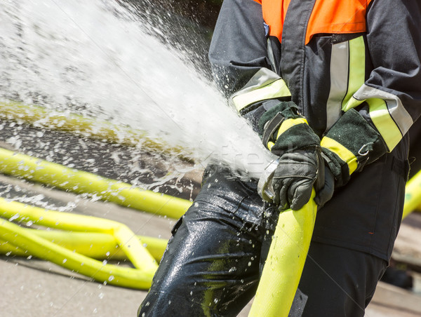 Fireman with a firehose Stock photo © manfredxy