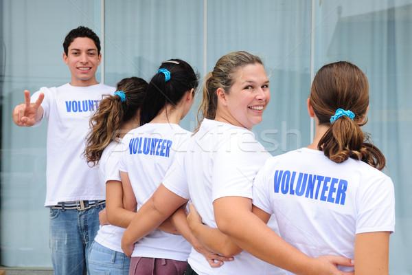 row of happy volunteers Stock photo © mangostock