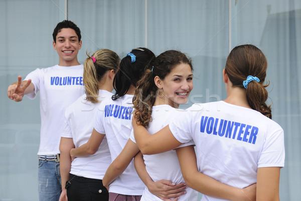 Rząd szczęśliwy wolontariusze różnorodny wolontariusz grupy Zdjęcia stock © mangostock