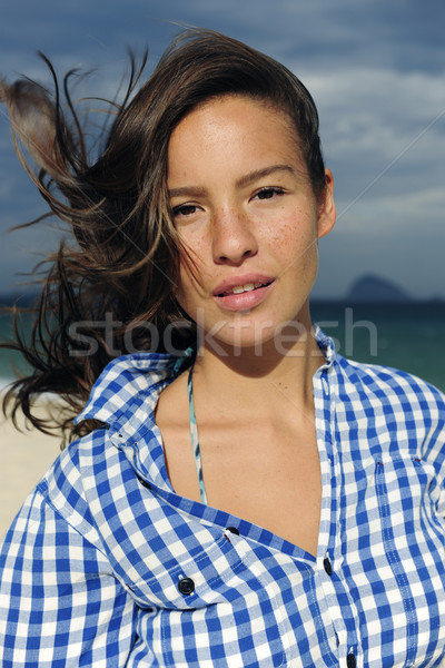 wind: woman with tousled hair at the sea  Stock photo © mangostock