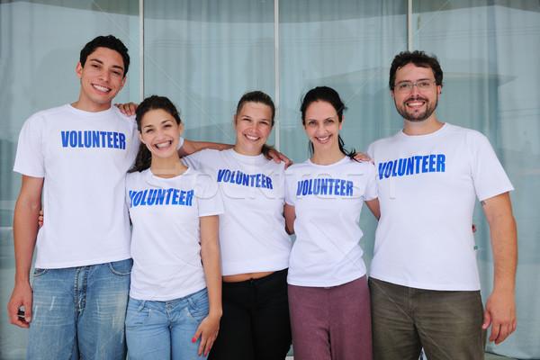 Gelukkig vrolijk vrijwilliger groep portret Stockfoto © mangostock