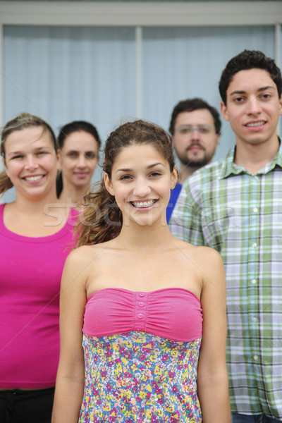 group of casual real people, teenage girl in front Stock photo © mangostock