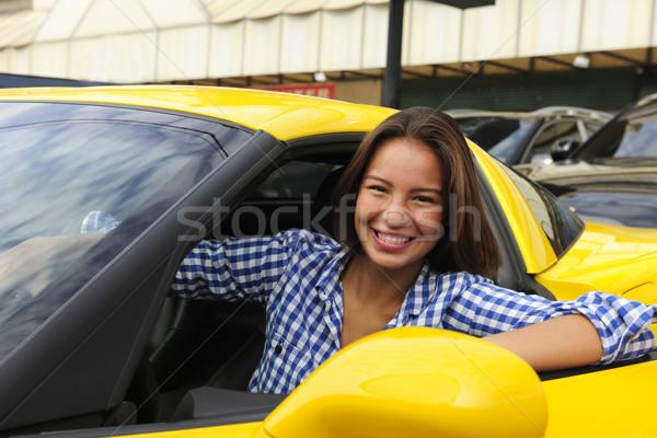 Kobieta posiedzenia wewnątrz nowego szczęśliwy Zdjęcia stock © mangostock