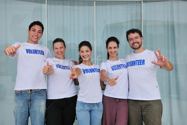Boldog derűs önkéntes csoport portré mosoly Stock fotó © mangostock