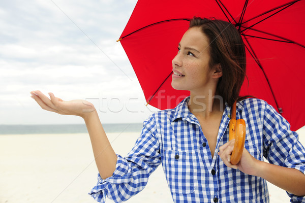 woman with red umbrella touching the rain Stock photo © mangostock