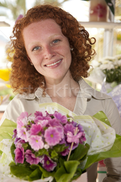 Flower gift: Woman giving a bunch of flowers Stock photo © mangostock