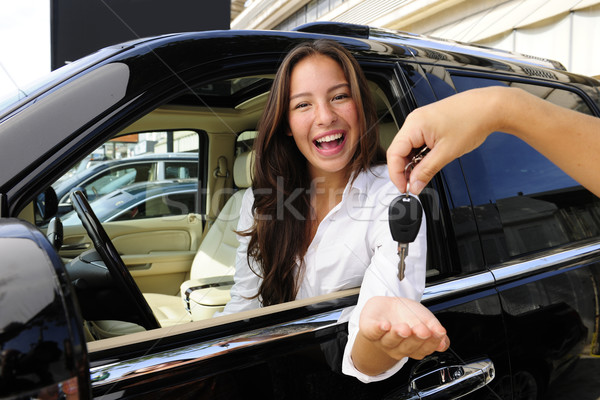 Stock photo: businesswoman receiving keys of her new off-road car