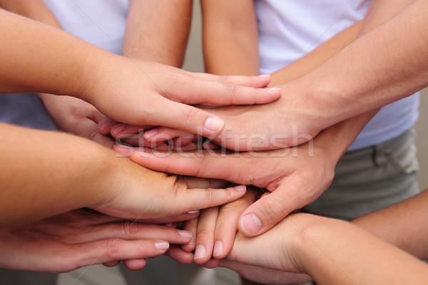 Zespołowej ręce wraz grupy strony mężczyzn Zdjęcia stock © mangostock