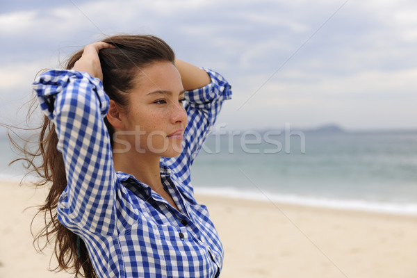beautiful woman relaxing by the sea with copy space Stock photo © mangostock