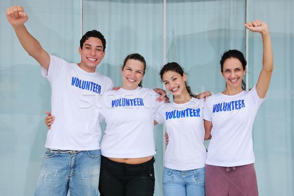 Heureux volontaire groupe portrait sourire Photo stock © mangostock