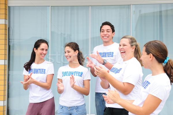 Boldog önkéntes csoport tapsol nevet mosoly Stock fotó © mangostock