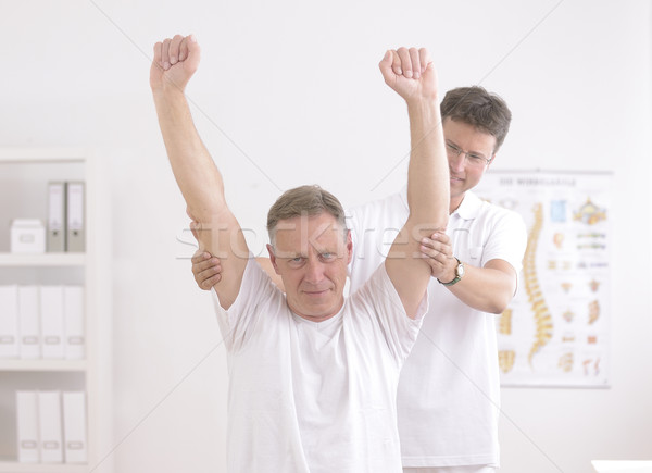 Physiotherapy: Senior man and physiotherapist Stock photo © mangostock