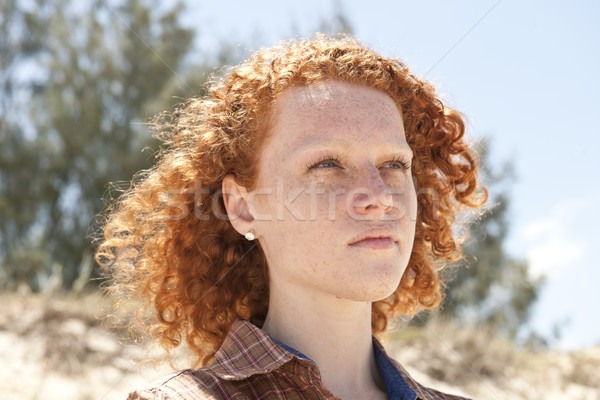 Portrait of a woman with red hair at the beach Stock photo © mangostock