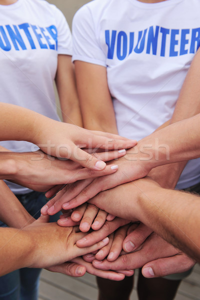 volunteer group hands together Stock photo © mangostock