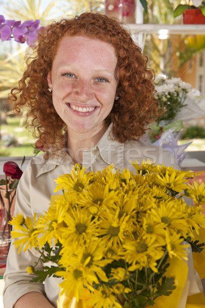 Woman buying flowers in a flower store Stock photo © mangostock