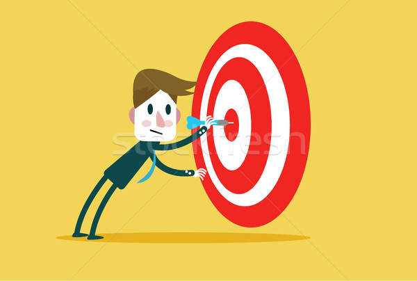 Corporate Guy Hits a Bulls-eye.  Stock photo © mangsaab