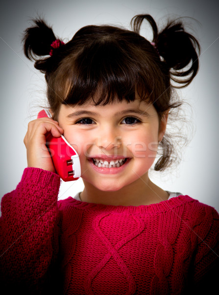 Petite fille portrait téléphone fille visage téléphone Photo stock © Marcogovel