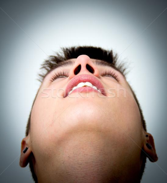 Adolescent jeune homme doigts sourire mode Photo stock © Marcogovel