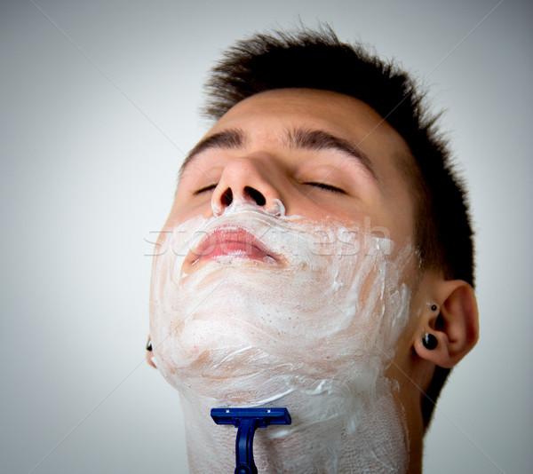 young man shaving Stock photo © Marcogovel