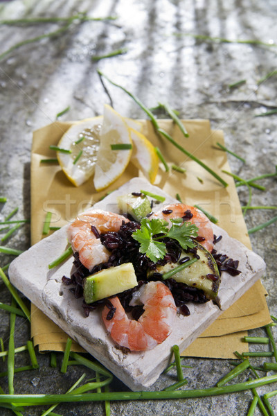 Black rice with shrimp and zucchini Stock photo © marcoguidiph