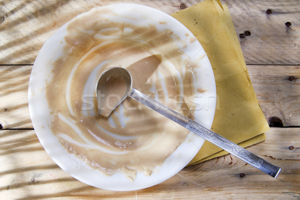 Dirty plate of cream Stock photo © marcoguidiph