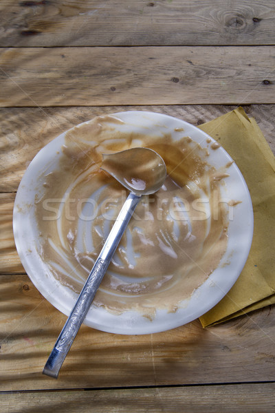 Stock photo: Dirty plate of cream