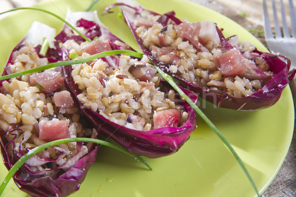Boat of brown rice with red radicchio and speck Stock photo © marcoguidiph