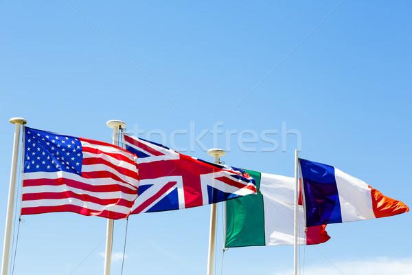 Drapeaux quatre pays ciel bleu ciel signe Photo stock © marekusz