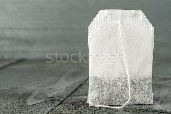Tea bag on wooden background Stock photo © marekusz