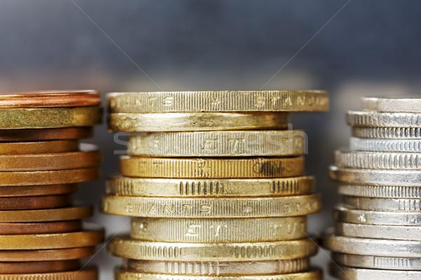 Coins against dark silver background Stock photo © marekusz