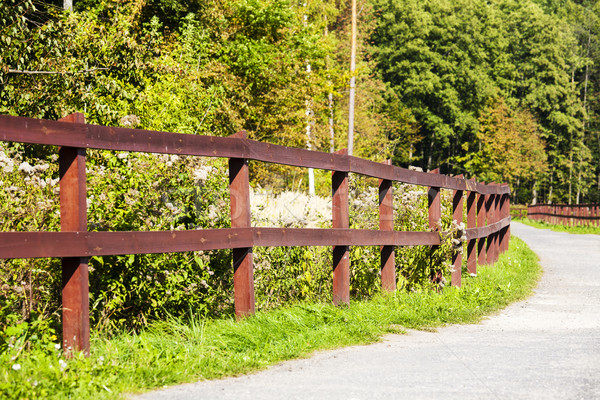 The wooden fence along a dirt road Stock photo © marekusz