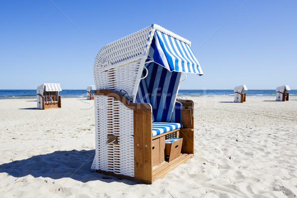 Wicker roofed beach chairs at the seashore Stock photo © marekusz