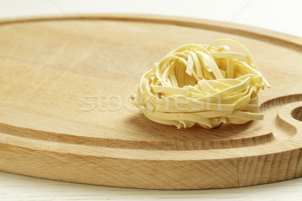 An uncooked pasta on a chopping board Stock photo © marekusz